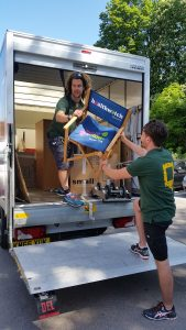 Picture of our magic movers from Anyvan lifting a chair out of the van.